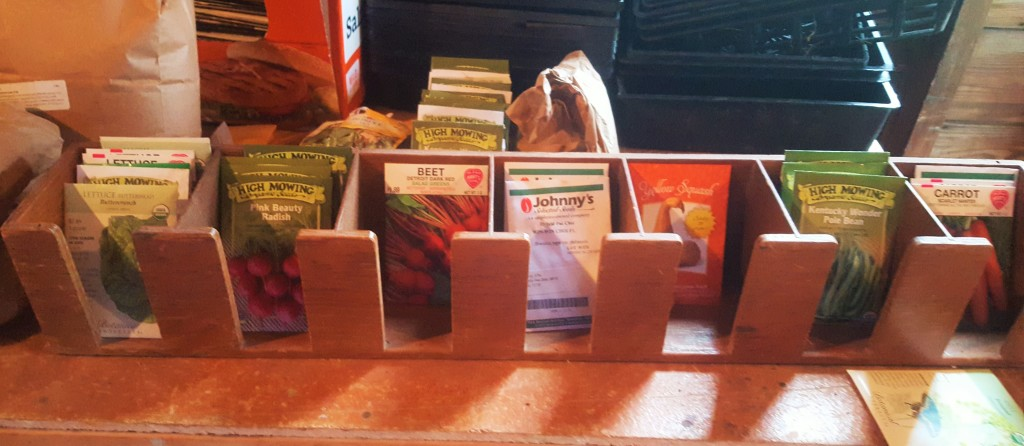 Seed packets are organized in the barn, waiting for their turn to be planted.